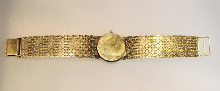 "Ladies Ebel watch in 18K gold with a diamond bezel set with single cut diamonds. Italian gold Corletto bracelet measuring 5 3/4"" in length.  The face of the watch is  25mm in diameter.  The dial has several very small hairline fractures."
