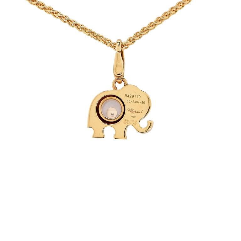 Chopard happy diamond elephant necklace at 1stdibs chopard happy diamond and sapphire elephant pendant necklace this whimsical pendant by chopard features one aloadofball Image collections