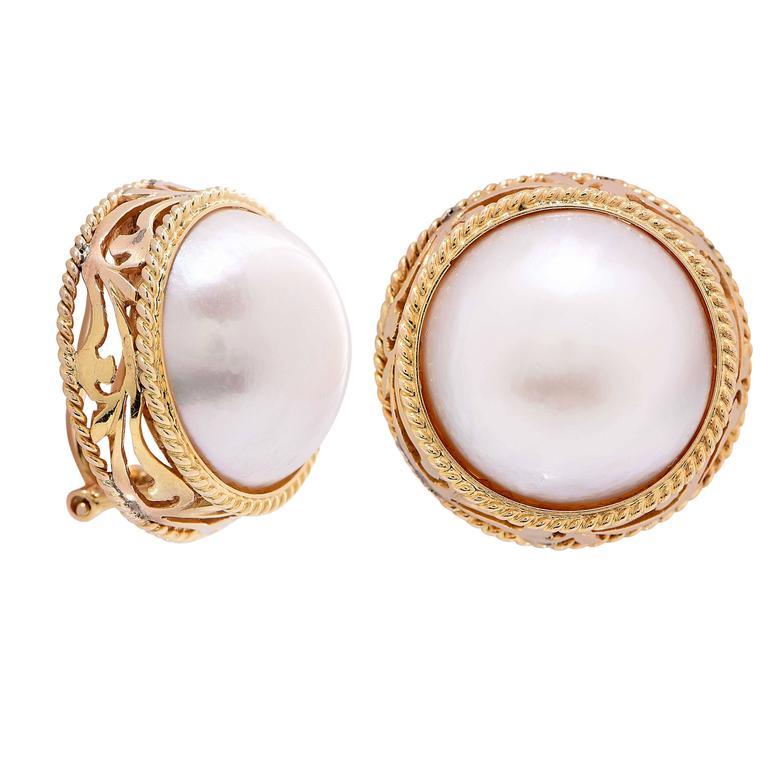 Mabe Pearl Earrings set in 14 Karat Yellow Gold.  Metal Type: 14Kt Yellow Gold Stamped Metal Weight: 17 Grams