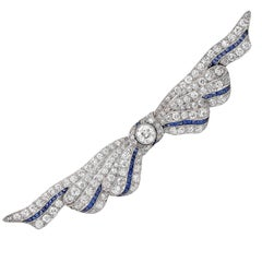3 Carat Diamond and Sapphire Ribbon Platinum Brooch. Circa 1930