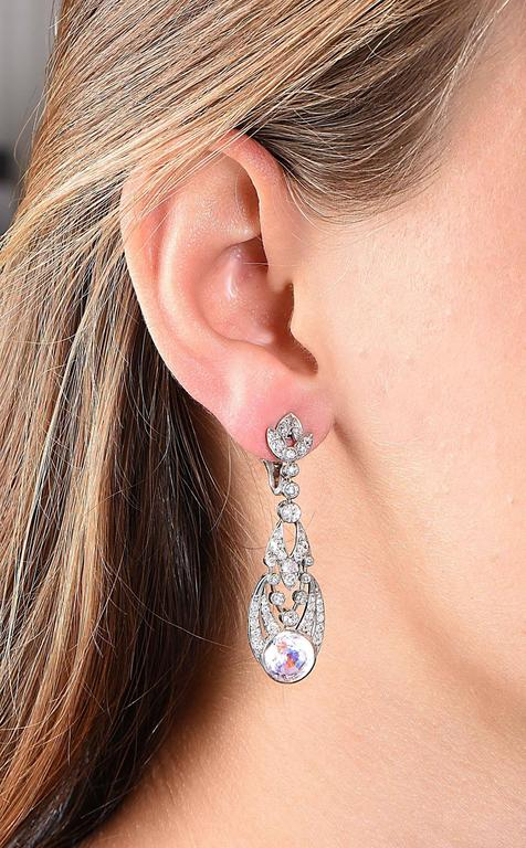 Ear-clips set with old mine and single cut diamonds, leading to large round rose quartz on the bottoms. Ear-clips are flexible.  Metal Type: Platinum Tested or Stamped Metal Weight: 12.6 Grams