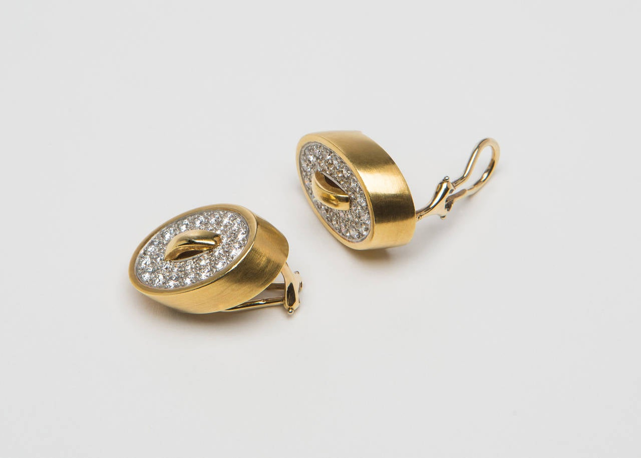 Iconic designer Angela Cummings creates a wearable gold and diamond earring. The Platinum center is set with brilliant cut diamonds and finished by a simple dimensional gold frame. 3/4 inches in length  Elegant and Chic !!!