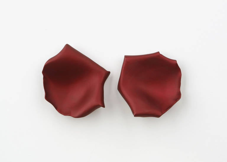 The only living jewelry designer to be honored by the Metropolitan Museum of Art.  JAR (Joel Arthur Rosenthal) creates wearable sculpture using the simple shape of a rose petal.  Aluminum and 18k gold combined to make chic wearable earrings.  Rare