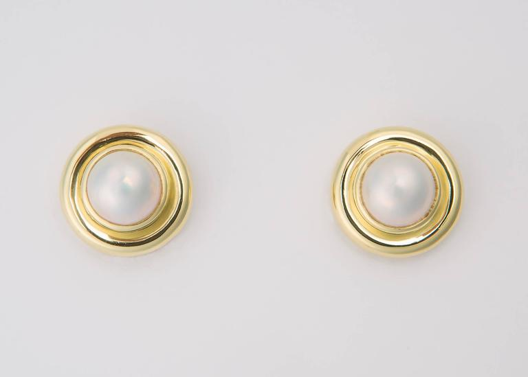 This is one of Paloma Picasso's truly classic designs created for Tiffany & Co. An elegant mabe pearl is framed with a rich 18k gold double bezel. Chic and wearable. Just over 3/4's of an inch.