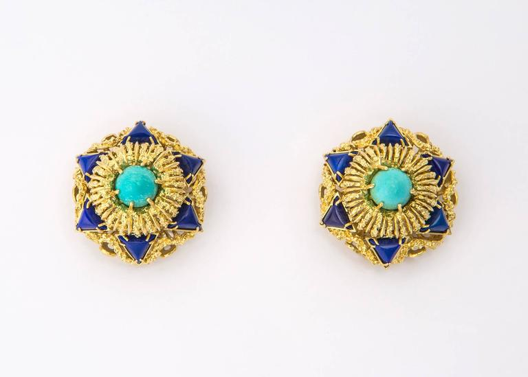 Bold and dimensional. Exceptional texture and detailing turn this earring into wearable art. Turquoise and lapis are the perfect color combination. A truly chic statement piece. 1 inch in size.