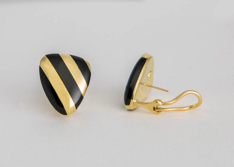 Classic stripes of black onyx and rich 18k gold create a chic easy to wear earring. Tiffany quality and design !  7/8's of an inch in length.