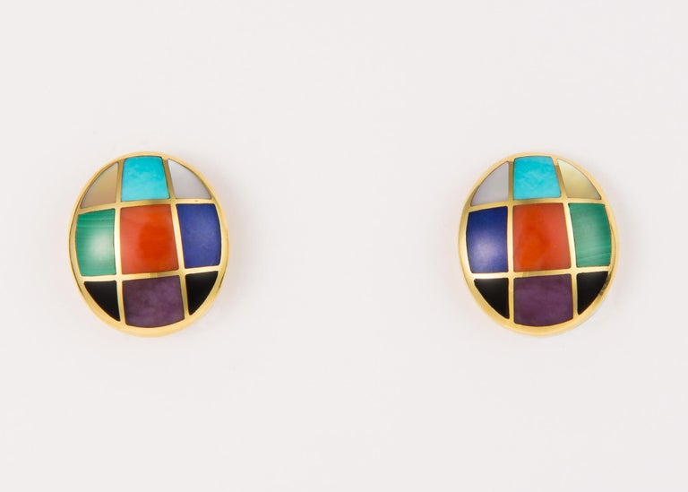 Asch Grossbardt combines turquoise, coral, malachite, lapis, mother of pearl, black onyx and purple sugilite in a playful geometric pattern. 3/4's of an inch in length.