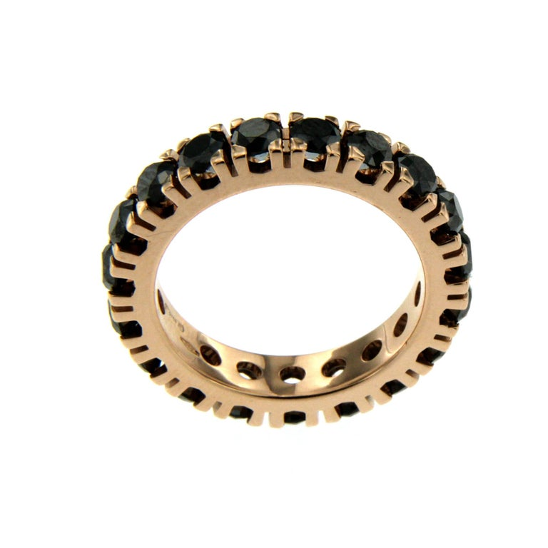 This timeless elegant black diamond eternity ring is set with black diamonds weighing approx. 2.60 carats, made in 18k rose gold. Its simple designs makes it the perfect everyday ring for any jewellery lover.   CONDITION: Brand New  METAL: 18k rose