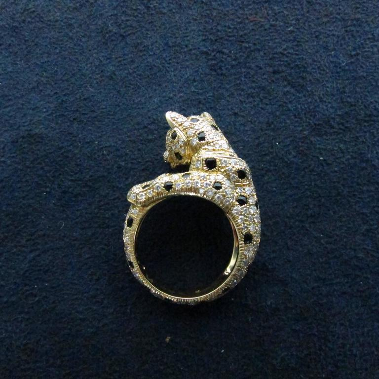 Modern Cartier Onyx Emerald Diamond Gold Panthere Ring For Sale