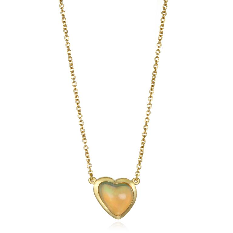 Faye Kim's 18k gold necklace features a lively Mexican Opal in the shape of a heart.   Bezel set and finished on a cable link chain, the necklace is adjustable in length, 16