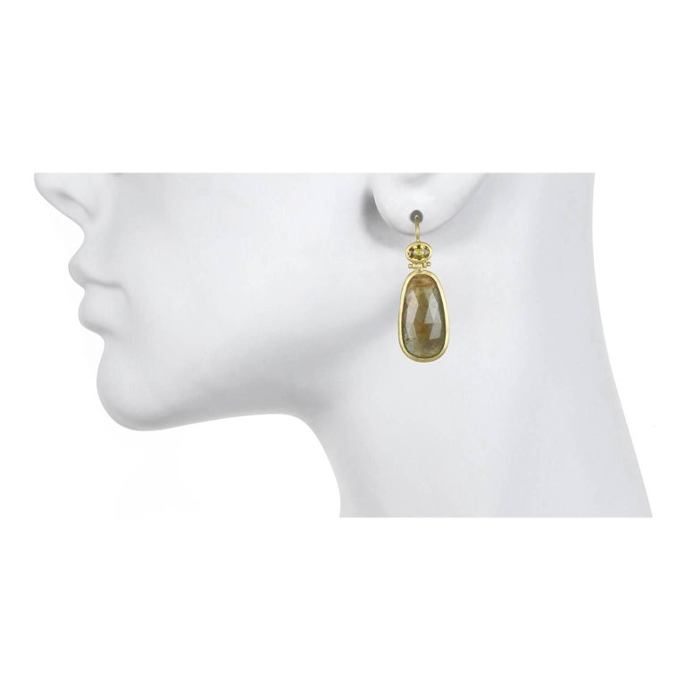 A striking and warm color combination is what makes these sapphire earrings unique.  They feature lightweight, faceted sapphires which give them a big impact but keeps them wearable from day to evening.   Handcrafted in 18k green* gold, rose cut