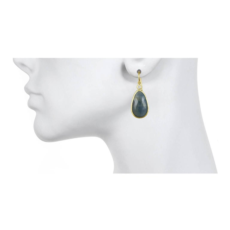 For those of us who appreciate and covet items that are truly unique, these earrings are it!  Handcrafted in 18k green* gold, rose cut blue sapphire slices are bezel set and paired with bezel set diamonds. The diamonds contrast and add a sparkle to