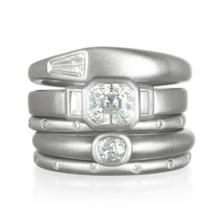 Faye Kim's handcrafted  Platinum diamond ring, set with an Old European Cut diamond is perfect on its own for the modern and minimalistic.  If you prefer to stack, layer it with diamond eternity bands to create our own unique style.   Size