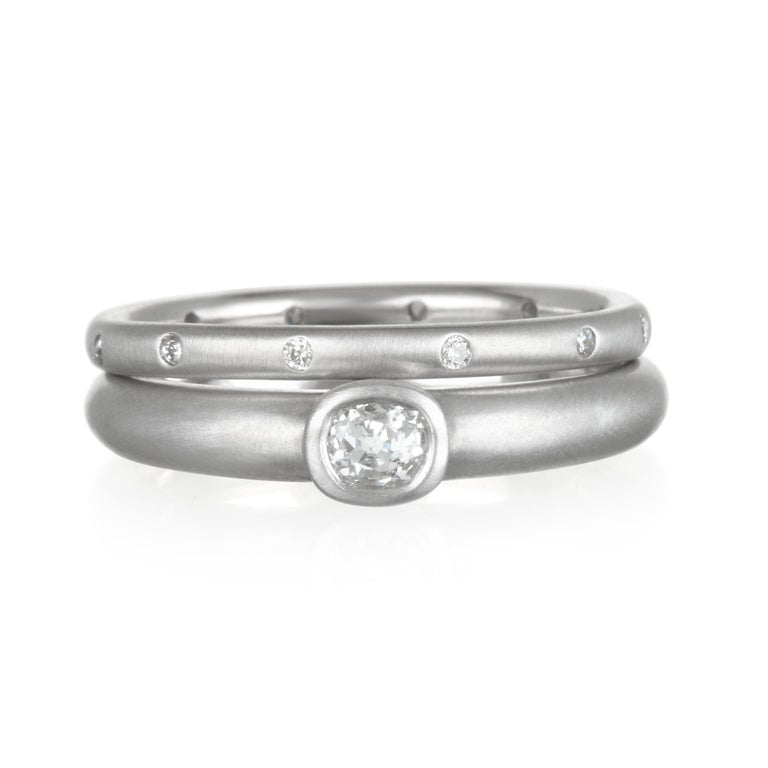 Modern and minimalistic. The gypsy set diamonds sparkle brightly against the platinum matte finish.  There is beauty in simplicity! Size 7.5,  Diamonds:  .10 Carats twt Rings sold separately.  Made in the USA