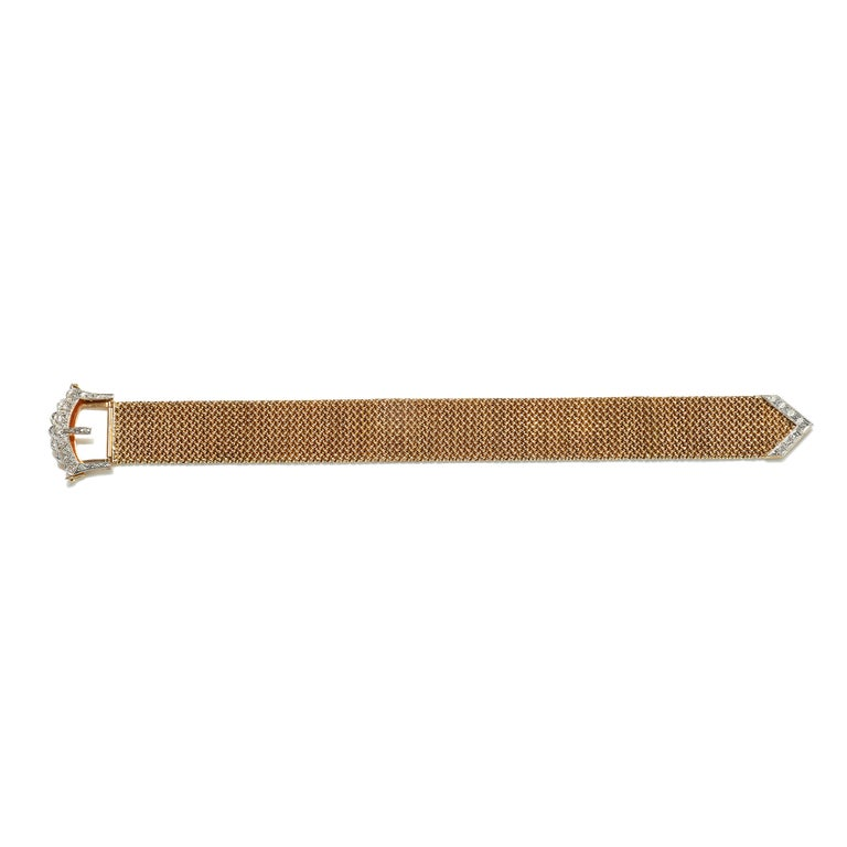 This vintage 18k Mesh Bracelet with Diamond Buckle is a masterpiece!  Beauty in simplicity while featuring flexibility, hip style and craftsmanship extraordinaire.  Although some claim retro style, it is no doubt a timeless look!  Diamonds are set