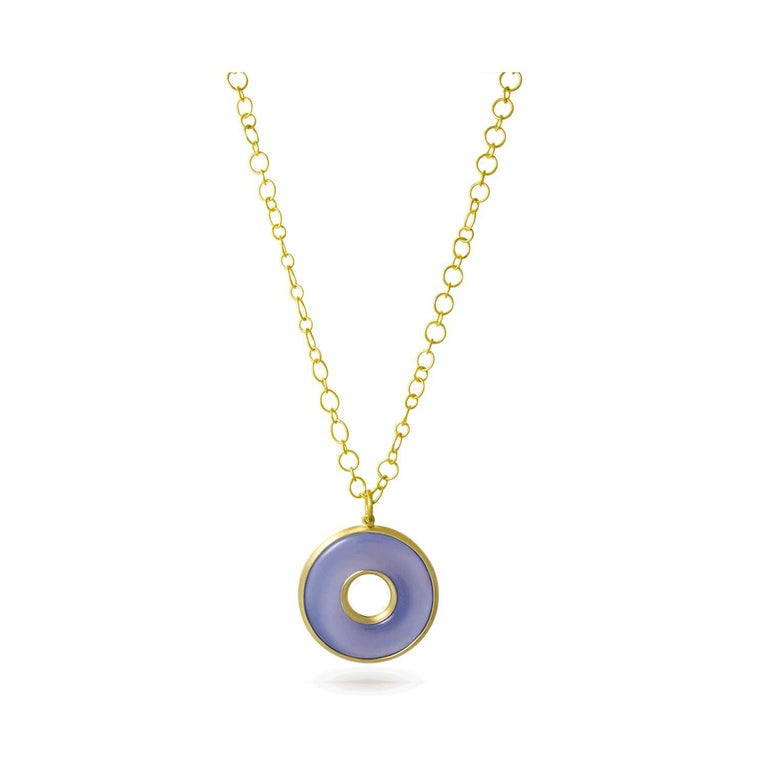 Circle of Life pendant in a soft shade of blue-gray chalcedony is custom cut and hand-framed in 18k gold.   Blue Chalcedony, a member of the quartz family has a quality that is translucent and ethereal invoking calm and peace. Featured on a handmade