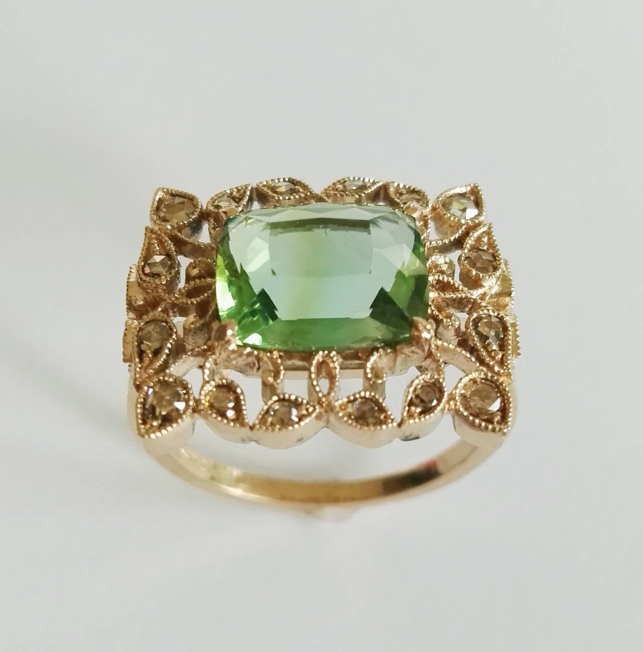Dalben design fashion ring mounted in 18 kt white gold with one Cushion cut Green Tourmaline weighting 3,14 carat and 22 rose cut light brown Diamonds weighing 0,44 carats.