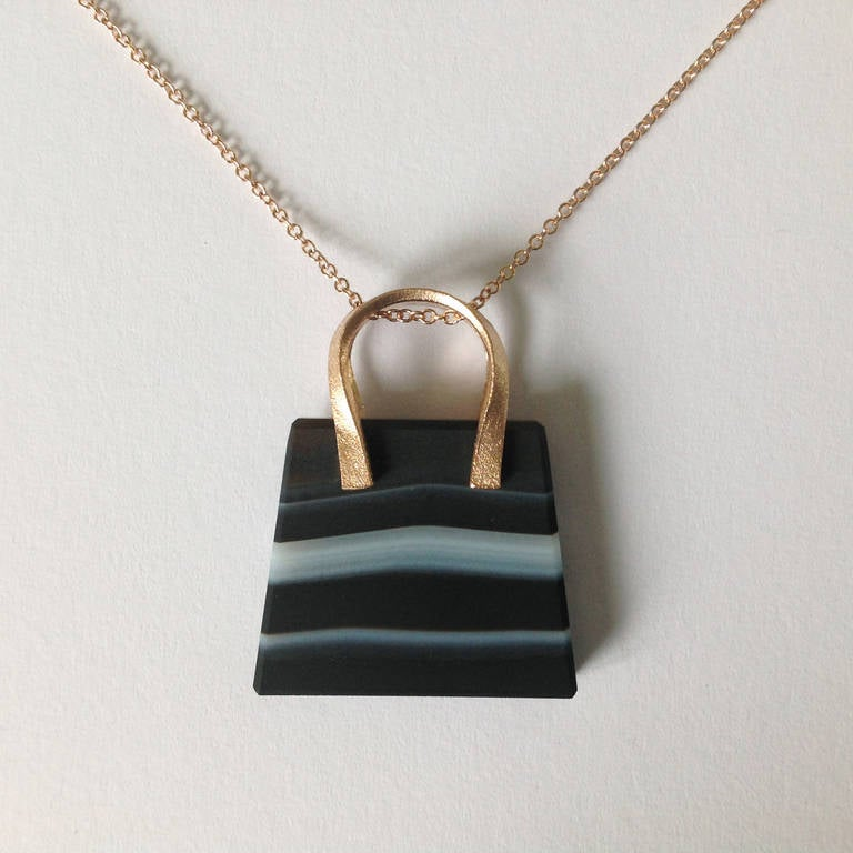 "Dalben design ""bag"" pendant necklace with banded Agate mounted in 18 kt rose gold .