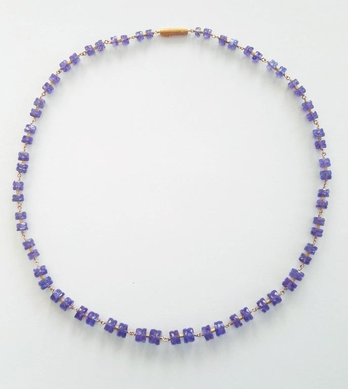 Dalben design hand crafted necklace composed of faceted tanzanite rondelle hand-linked with 18 k yellow gold. The necklace length is 17 inch (43 cm) and the yellow gold closure is satin hand engraved.