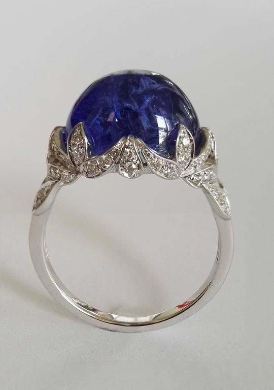 Dalben design white gold ring with an oval cabochon cut Tanzanite weight 8,70 carat and 44 white round brillant cut Diamonds weight 0,23 carats mounted in 18 k white gold.  Head ring dimension : height 12 mm, width 16 mm. Ring size 7 1/2 USA - 56