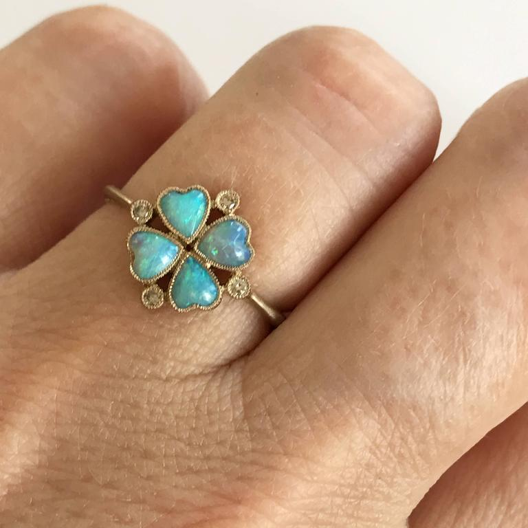 Dalben design four-leaf clover Australian Opals little ring with 4 heart shape Australian Opals and 4 light brown round brilliant cut Diamonds weighing 0,04 carats mounted in 18 kt warm white gold.    Four-leaf clover dimension: 9,4 mm.  Ring size 5