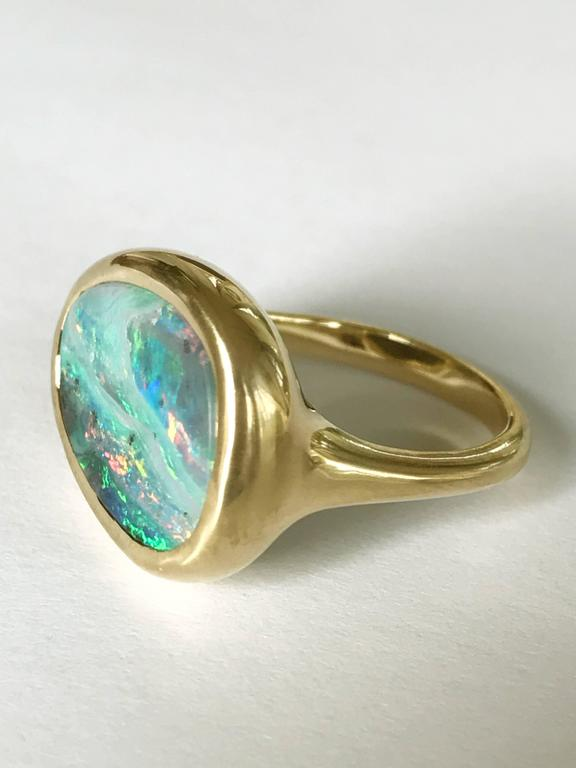 Dalben design One of a kind 18k yellow gold semi lucid finishing ring with a 6,7 carat bezel-set lovely Australian Boulder Opal .   The stone colors looks like a Stormy sky on the sea. .   Ring size 6 3/4 - EU 54 re-sizable to most finger sizes.