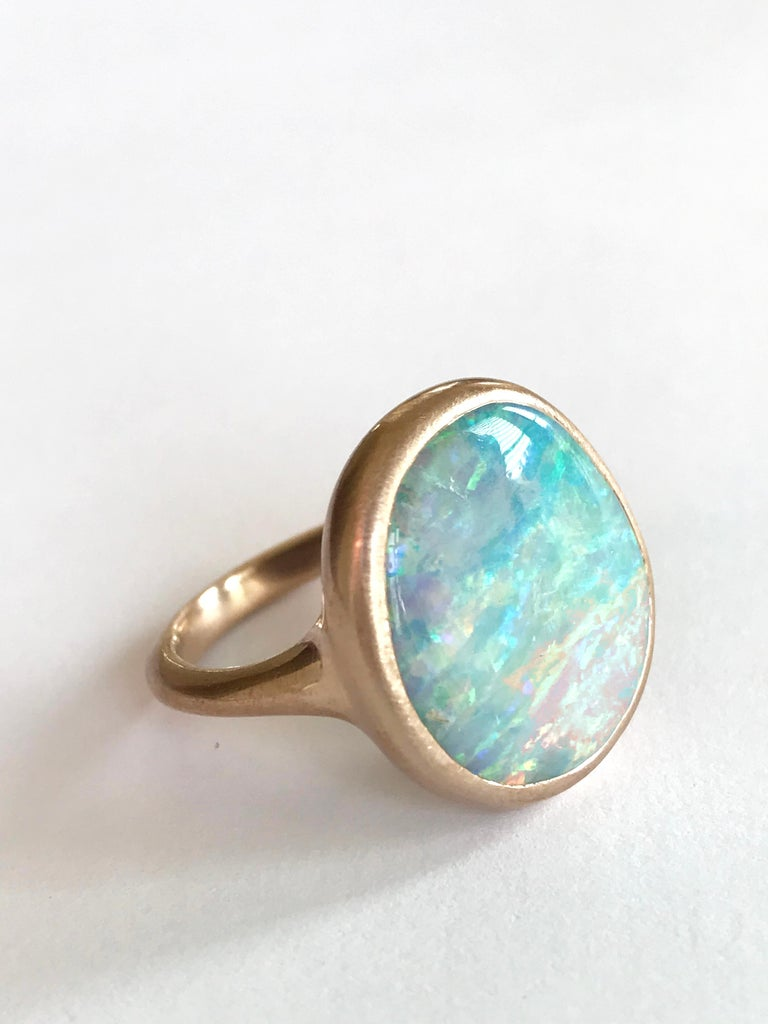 Dalben design One of a kind 18 kt rose gold matte finishing ring with a 9,8 carat bezel-set wonderful Australian Boulder Opal .   The stone has pastel colors with blue , green , pink and yellow light spots. Ring size 6 3/4 - EU 54 re-sizable to most