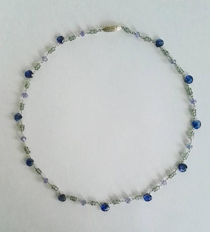 Dalben design hand crafted necklace composed of pear cut kyanite, green sapphire , tanzanite and 18 k white gold.