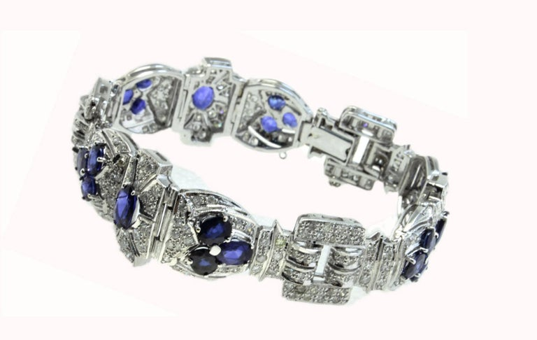 Charming choosing of colors for this retro bracelet composed of shiny diamonds and embellished with drops of blue sapphires. All is mounted in 18 Kt white gold. Tot weight 36.3 g Diamonds 5.42 ct Blue sapphires 10.52 ct  Rf. gugef