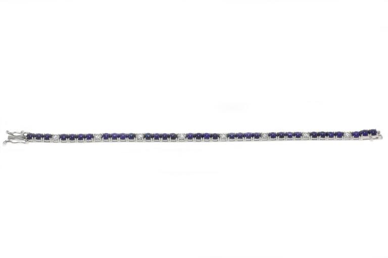 Everyday is a good occasion to wear this charming Tennis bracelet, with a strand of sparkling blue sapphire and diamonds all mounted on white gold.  US Size Diamonds 2.13 ct Sapphires 13.35 ct Lenght 7.08 inches Width 0.17 ref,ieoc