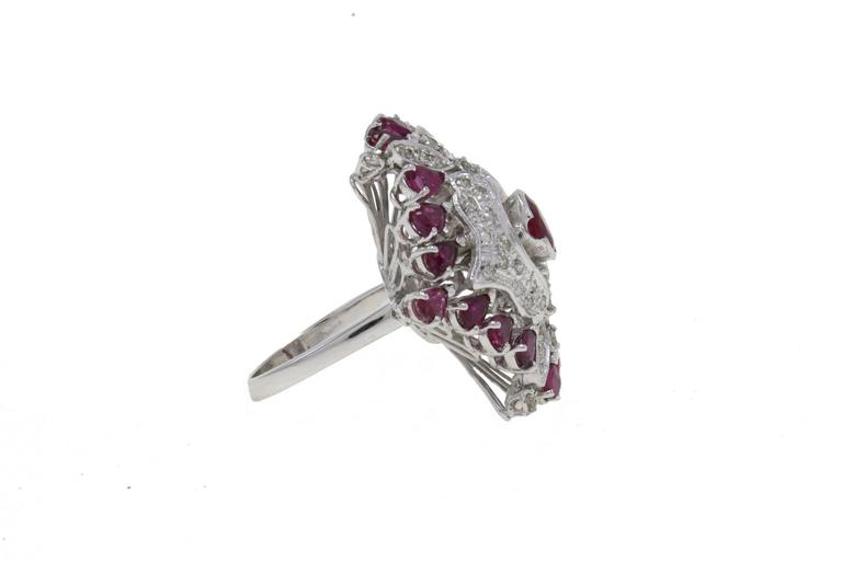 Sparkling ring in 14kt white gold embellished with a central ruby surrounded by diamonds and a crown of rubies. diamonds 1.92kt rubies 4.55 kt tot weight 14gr US Size Width 0.99 inches Lenght 1.18 inches Diameter 0.62 inches ref fhor  For any