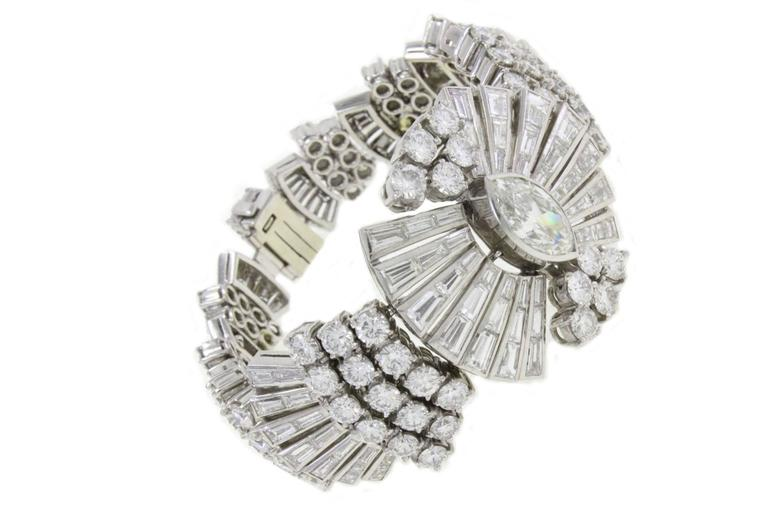 Shiny and amaziong platinum bracelet covered in baguette and brilliant cut diamonds and a heart of marquise. platinum base 82.8gr  diamonds (16 Kt) heart of marquise (3.5 Kt).  tot weight 88.8gr US Size Width 1.22 inch Length 6.30 inch Ref. Cod.