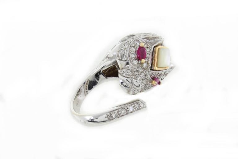 Stylized lion ring in white gold 14 kt covered by diamonds, with rubies eyes. diamond-1.43 kt  rubies 0,40 kt Total weight 20gr ring size 6,25 ref 324056  For any enquires, please contact the seller through the message center.