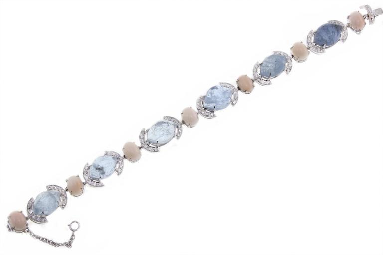 Amazing bracelet in 14Kt white gold composed of diamonds, pink coral and aquamarine linked together.  diamonds(1.83Kt) ,  pink coral (1.70gr)  aquamarine (21.50Kt),  Tot. weight 18.8 gr Rf ocuu