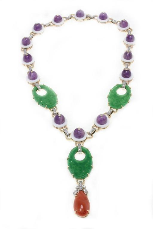 Exotic necklace in 14Kt white and yellow gold composed of diamonds that link the amethyst to the white agate and gemstone. On the bottom of the necklace you can find drop of coral.  diamonds(1.59Kt) amethyst (97Kt) white agate and gemstone(16.60