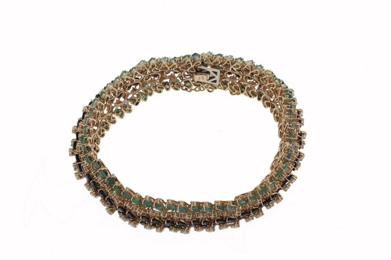 Retro Emerald and Sapphire and Diamonds Gold Strands Bracelet For Sale