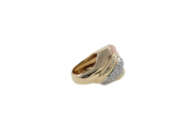 Fashion ring in 14k yellow and white gold mounted with diamonds tsavorite onyx and coral. Diamonds 0.95 kt Tsavorite 1.06 kt Onyx 0.10 gr Coral 2.00 gr Tot.Weight 22.20 gr  R.F oiai