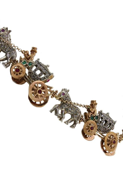 This fashion design chaise choker necklace it is mounted in 9Kt rose gold and silver all the diamonds make shiny the horse's body and the chaise (3.55Kt) and details of rubies and emeralds (2.57Kt).Tot weight 88.7 gr R.f. 174063