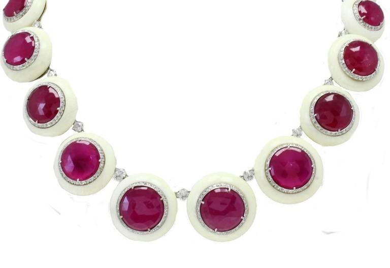 Amazing necklace in 14kt white and yellow gold composed of stone circles of different dimensions and on it there are rubies circles surrounded by diamonds. Every circle is linked by a diamond.  diamonds 5.30kt rubies 78.57kt stones 51.80gr tot