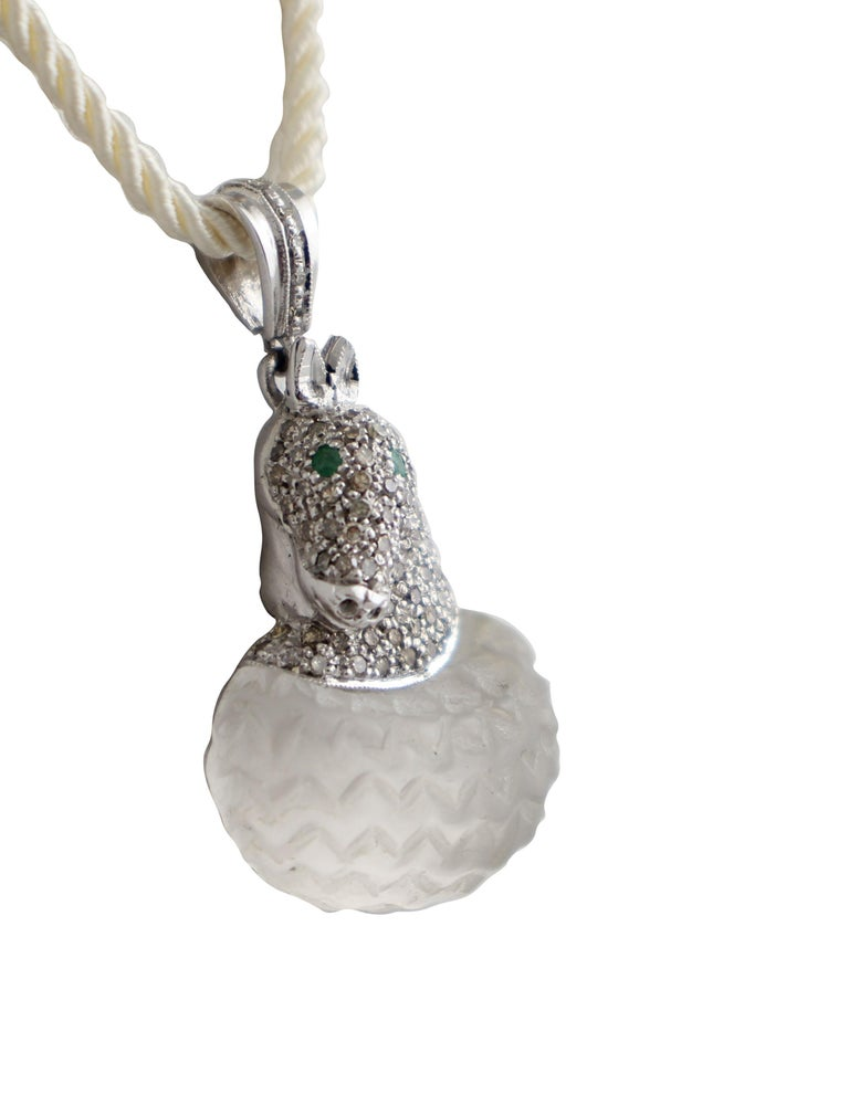 Horse shaped pendant in 14kt white gold and silver composed of two emerald eyes, a face covered in diamonds and a rock crystal body.  diamonds 0.72kt emeralds 0.05kt rock crystal 3.8gr tot weight 10.4gr r.f.  goio  We hereby inform our customers