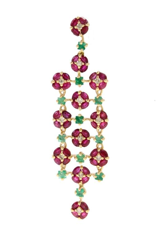 Lustrous earrings in 14Kt yellow gold simply composed of rubies, emeralds and shiny diamonds.   Tot weight 11.9 gr R.f. 537192