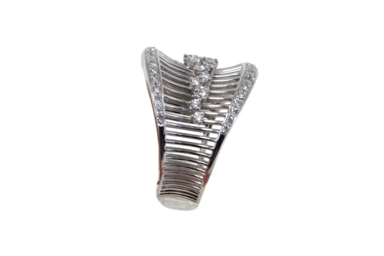 Shining band ring in 18K white gold composed of several stripes of gold embellished with 0.80 ct of white diamonds. Diamonds 0.80 ct Total Weight 10.20 g R.F + foho  For any enquires, please contact the seller through the message center.