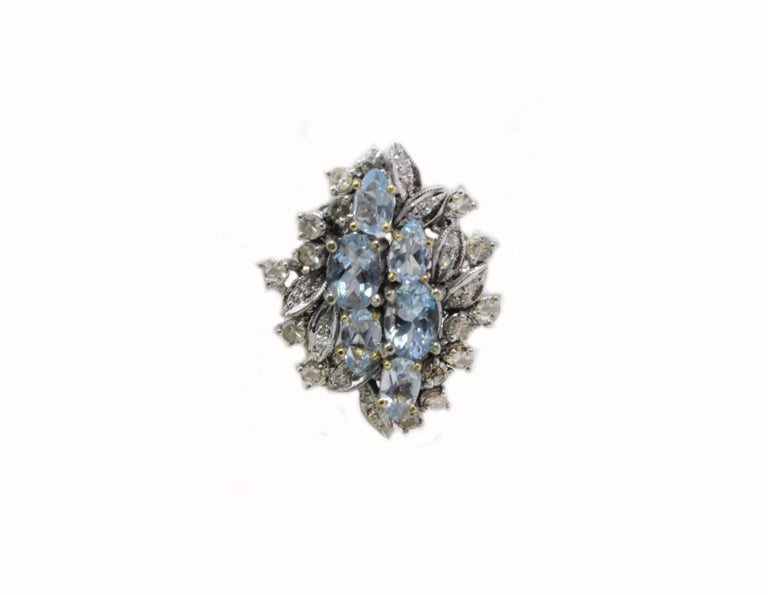 The simplicity in a classic stud earrings composed of shiny aquamarines surrounded of diamonds mounted in 14 Kt white gold. Tot weight 9.4 g both earrings, single one 4.7 g Diamonds 1.34 ct Aquamarines 3.96 ct  Rf. uffh