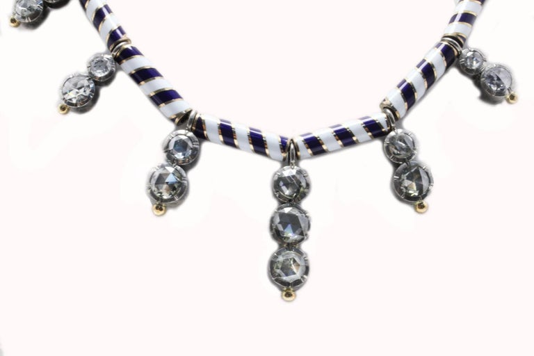 A must of the '70 style, this necklace is composed of drop of old rose cut diamonds set on a blue and white enamel strand. All is mounted 14Krose gold and silver structure. Diamonds 15.13 ct Total Weight 103.50 g  R.F + uegei