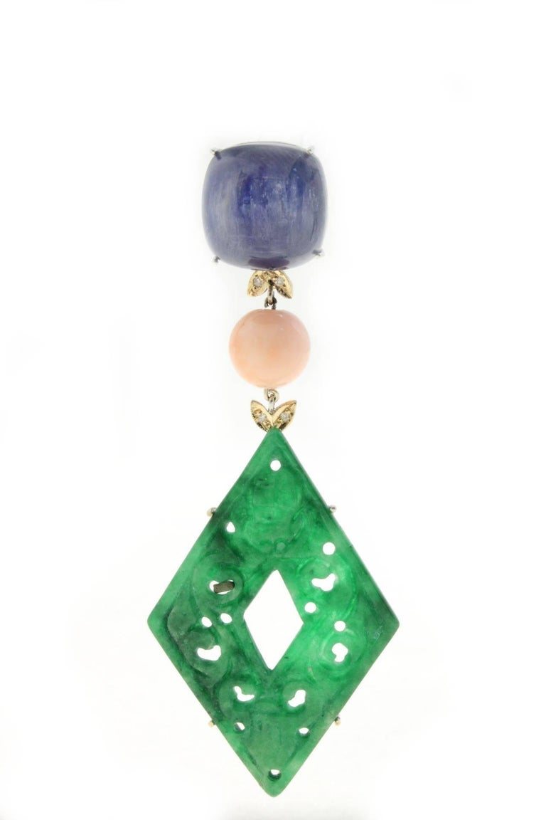 Fascinating dangle earrings composed of a kyanite stone on top that's link through a coral sphere to a rhombus shape malachite. All is mounted in 14 Kt rose gold and 14 kt white gold. Tot weight  21 g both earrings, single one 10.5 g Malachite and