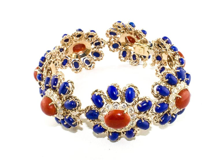 Fantastic bracelet in rose gold +14 kt, g 51.00, with design in the shape of small flowers, enriched with diamonds 6.54 ct, lapis gr 6.10, and fantastic  coral as central on each flower from gr 2.85. Diamonds ct 6.54 Coral g 2.85 Lapis g 6.10 Total