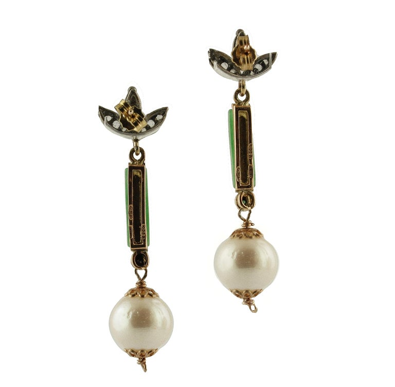 Elegant stud earrings in 9K rose gold and silver composed of diamonds leaves detaile at the top, green jade in the middle, and emeralds and white pearls at the bottom  Diamonds 0.15 ct  Emeralds 0.06 ct  Green Jade 1 g  White Pearls 4 g    11