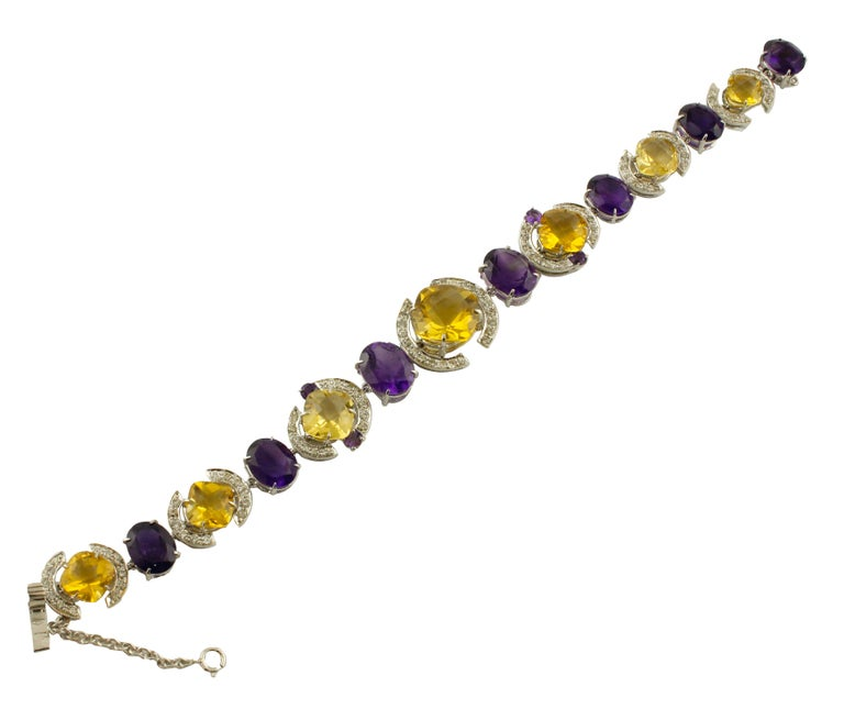 Amazing link bracelet in 14K white gold mounted with yellow tapazes, amethysts and white diamonds detailes Diamonds 2.27 ct  Yellow Topazes, Amethyst 36.90 ct  Total Weight 23 g  R.F + ioca Length 19 cm