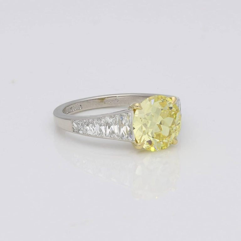 2.41 Carat Fancy Intense Yellow Diamond Ring with Tapering French-Cut Diamond In Good Condition For Sale In London, GB
