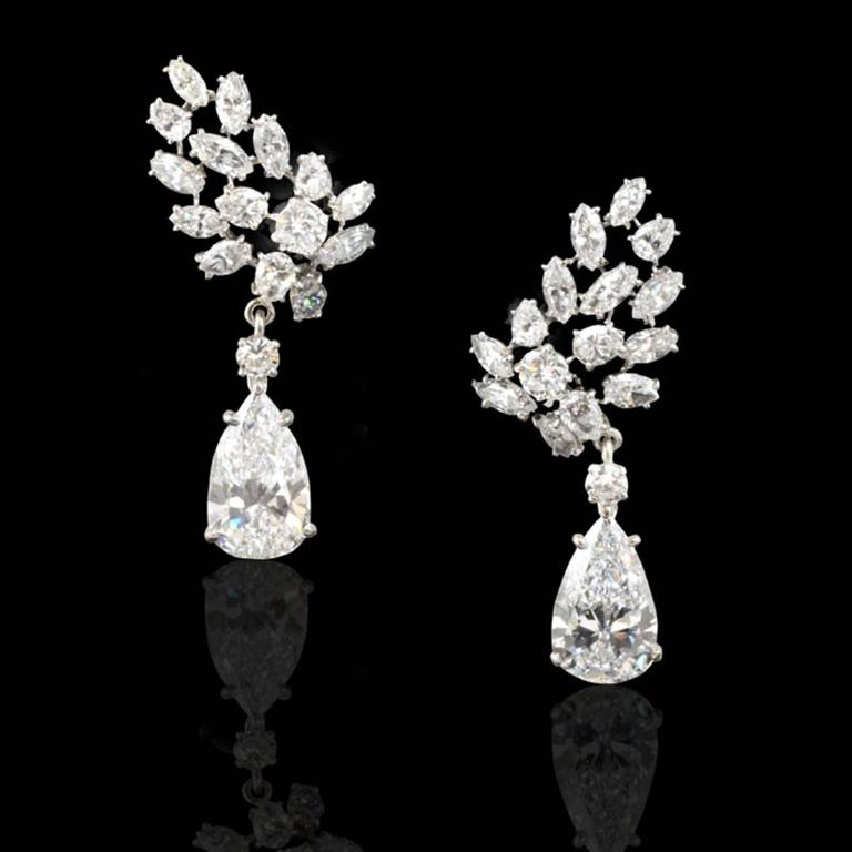 The stunning earrings with detachable pear shaped diamond drops weighing 4.22ct and 4.02ct respectively, both of D colour and IF clarity accompanied by GIA certificates, four claw set in platinum mounts and suspended from an articulated small round